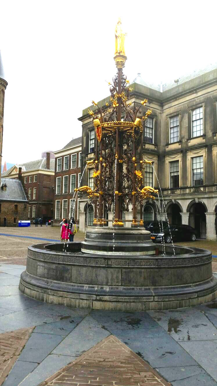 A fountain painted in gold