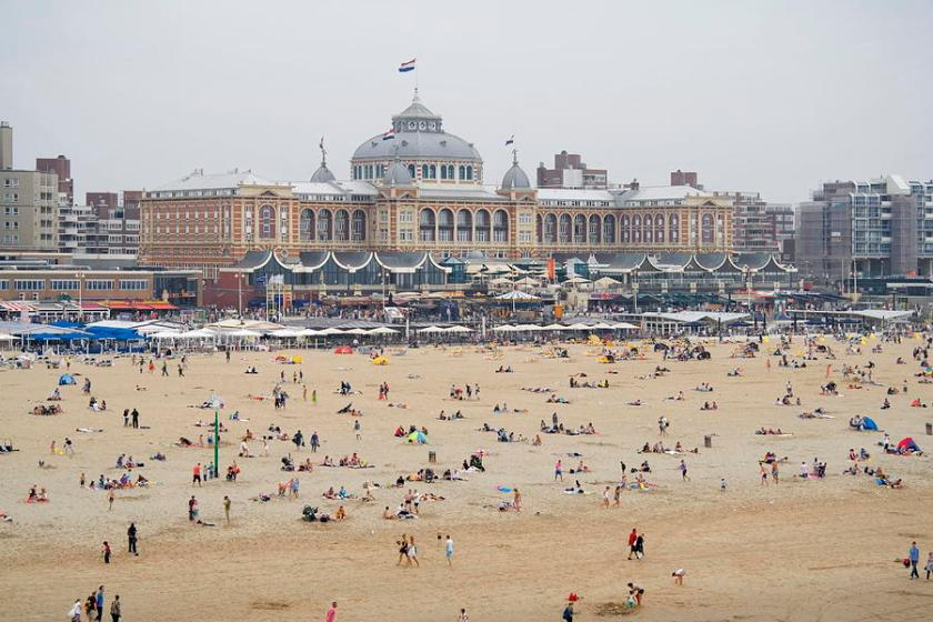 the-beach-with-a-backdrop-of-the-kurhaus-in-scheveningen-netherlands-ronald-jansen